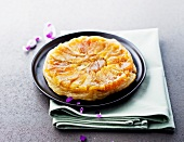Apple and violet tatin tart