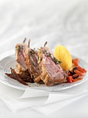Roasted loin of lamb with rosemary in flower, potatoes with tomato flash and dates