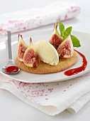 Breton shortbread cookie topped with figs, vanilla ice cream and raspberry puree
