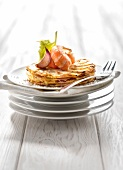 Pommes Anna-style celeriac galettes,with roasted Dublin Bay prawns