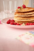 Lemon,ricotta and popyseed pancakes with fresh raspberries