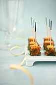 Salmon cubes marinated in dill