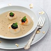 Cream of foie gras soup with scallops and caviar