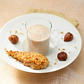 Foie gras coated with crushed nuts and served with chestnut cream