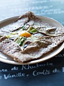 Green and white asparagus and egg Galette