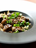 Snails with spring onions