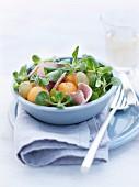 Corn lettuce,melon, grape and ham salad