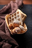 Sprinkling the waffles and donuts with icing sugar