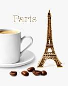 Komposition mit Mini-Eiffelturm, Tasse Kaffee und Kaffeebohnen vor weißem Hintergrund