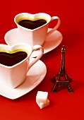 Composition with a mini Eiffel Tower,and two heart-shaped cups of coffee