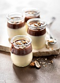 Panna cotta with chocolate sauce and crushed almonds