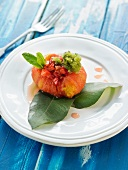 Sweet tomato stuffed with diced strawberries and mint-green tea granita