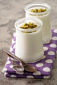 White chocolate cream dessert with pistachios