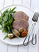 Sliced shoulder of lamb with spices and vegetables