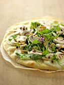 Mushroom, rocket lettuce and pine nut white pizza