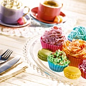 Assorted multicolored cupcakes and macaroons for tea