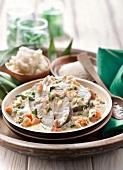 Moqueca de peixe, fish in coconut sauce