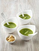 Cream of asparagus soup with confit citrus
