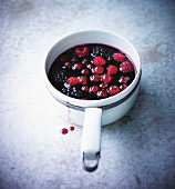 Saucepan of stewed summer fruit