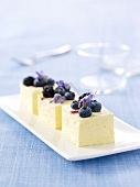 Small Parfaits topped with blackberries, blueberries and crystallized borage