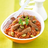 Beef with stewed tomatoes, capers and chopped gherkins