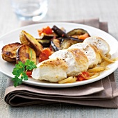 Chicken breast with onions,pan-fried eggplants and oven-roasted potatoes