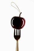 Cherry to hang on the end of a fork