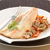 Fillet of trout with creamy sauce,mushrooms,tomatoes and onions