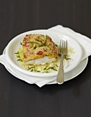 Cod in cheese and tomato crust