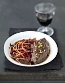 Flank wok with grated carrots and beetroots