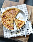 Onion and diced bacon savoury tart