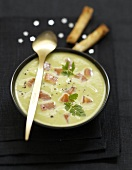 Cream of green asparagus soup with smoked salmon