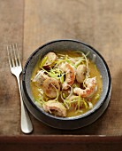 Pan-fried Dublin Bay prawns,white sausages and leeks with cider