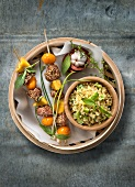 Sesame seed duck,mango and kumquat brochettes,green tomato tabbouleh