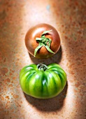 Still life with green and red tomato