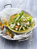 Thin strips of zucchini,pea,lettuce heart,croutons and parmesan salad
