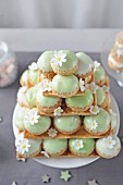 Pyramid of frosted cream puffs