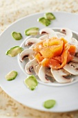 Button mushroom carpaccio with smoked salmon