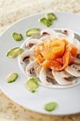 Button mushroom carpaccio with smoked salmon