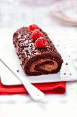 Chocolate and raspberry Christmas log cake