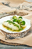 Cod with herb butter, pan-fried Brussel sprouts and leeks