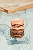 A strawberry and a chocolate macaroon
