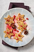 Star-shaped pancakes with honey and pomegrante seeds