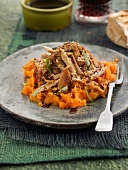 Flaked confit pork chops with sweet potato and carrot mash