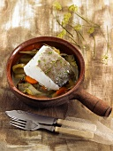 Stewed salt cod with artichokes and carrots