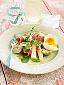 White asparagus, artichoke and raw ham salad with a soft-boiled egg