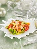 Shrimp, avocado and orange salad with cocktail sauce