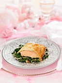 Salmon in pastry crust and spinach fondue