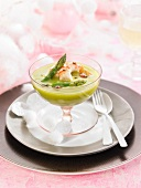 Cream of green asparagus with grilled king prawns and hot pepper oil
