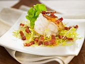 Monkfish with diced bacon and curly endive